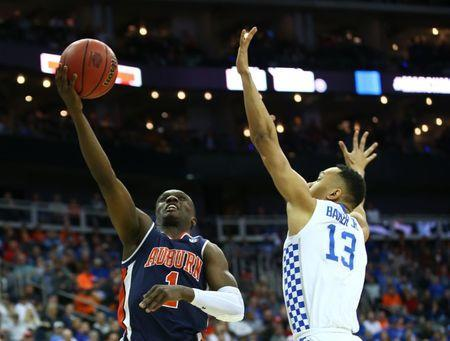 Mar 31, 2019; Kansas City, MO, United States; Auburn Tigers guard Jared Harper (1) shoots against Kentucky Wildcats guard Jemarl Baker Jr. (13) during the first half in the championship game of the midwest regional of the 2019 NCAA Tournament at Sprint Center. Jay Biggerstaff-USA TODAY Sports