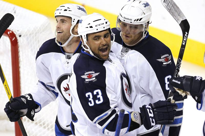Winnipeg Jets' Andrew Ladd (16), Dustin Byfuglien (33) and  Nik Antropov (80) celebrate a Jets goal against the Columbus Blue Jackets during the third period of a preseason NHL hockey game in Winnipeg, Manitoba, on Tuesday, Sept. 20, 2011. (AP Photo/The Canadian Press, John Woods)