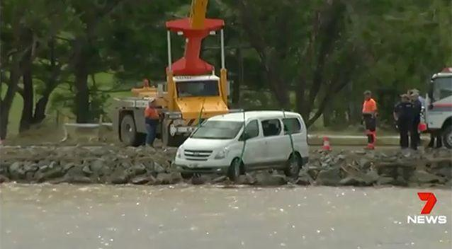 The family's van slid off a muddy road and plunged into the Tweed River. Picture: 7 News