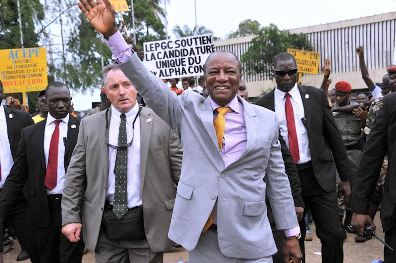 Guinea President Alpha Conde (C) waves at supporters of his party, The Rally of the Guinean People (RPG) on August 11, 2015 in Conakry, after his nomination as candidate for the next presidential election in October