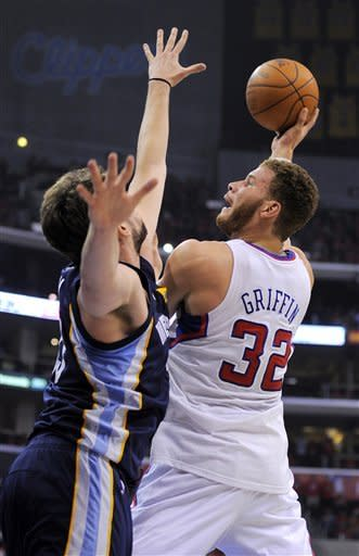Los Angeles Clippers forward Blake Griffin, right, shoots against Memphis Grizzlies center Marc Gasol, of Spain, during the first half of Game 6 in their first-round NBA basketball playoff series, Friday, May 11, 2012, in Los Angeles. (AP Photo/Mark J. Terrill)