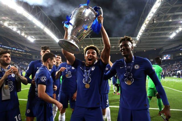 Chelsea right-back Reece James celebrates with the Champions League trophy