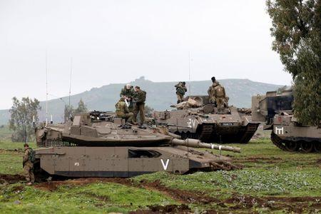 Israeli soldiers take part in an exercise in the Israeli-occupied Golan Heights, near the ceasefire line between Israel and Syria
