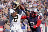 New Orleans Saints quarterback Jameis Winston (2) eludes New England Patriots outside linebacker Matt Judon (9) as he looks to pass during the second half of an NFL football game, Sunday, Sept. 26, 2021, in Foxborough, Mass. (AP Photo/Steven Senne)
