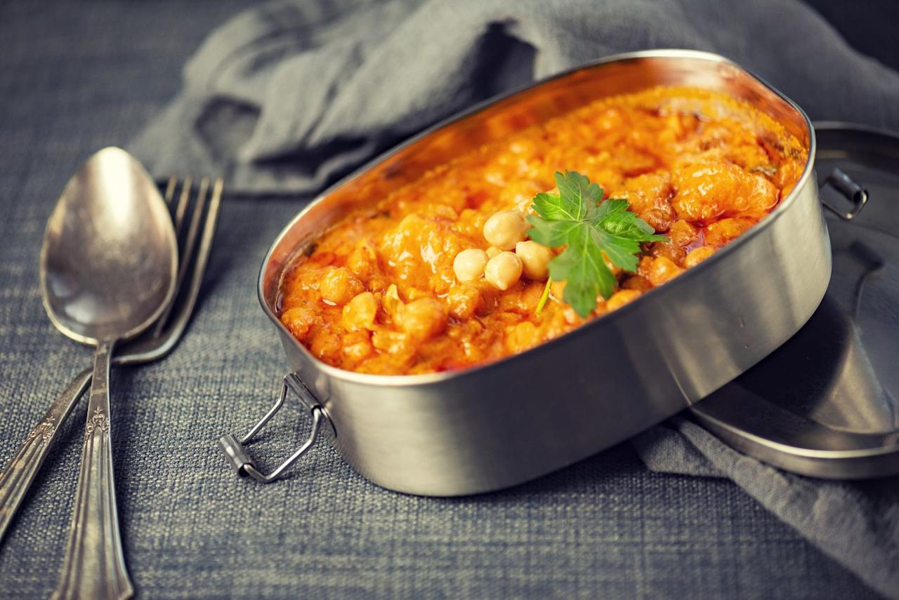 <p>Chickpeas are high in protein. (One cup contains 15 grams for 269 calories.) Protein stops grumbling guts. And chickpeas are also delicious, even in canned form, if you combine them with the right spices.</p><ol><li>In a large pan over medium heat, add 1 Tbsp of olive oil. Add 1/4 medium onion (chopped) and 1 garlic clove (minced), and cook until the onion is softened, 3 to 5 minutes. Add 2 tsp ground curry powder and cook until aromatic, about 30 seconds. Add 1 (15 oz) can chickpeas (rinsed and drained) and cook until heated through, about 1 minute.</li><li>Season with salt and pepper, to taste, and melt in 1 Tbsp of ghee or butter, if you have it.</li><li>Serve with cooked basmati rice, if you have that too.</li></ol>