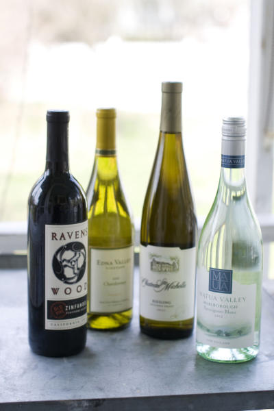 This image taken on April 29, 2013 shows, from left, Ravenswood Zinfandel, Edna Valley Chardonnay, Chateau St. Michelle Eroica Riesling and Matua Valley Sauvignon Blanc wines in Concord, N.H. (AP Photo/Matthew Mead)