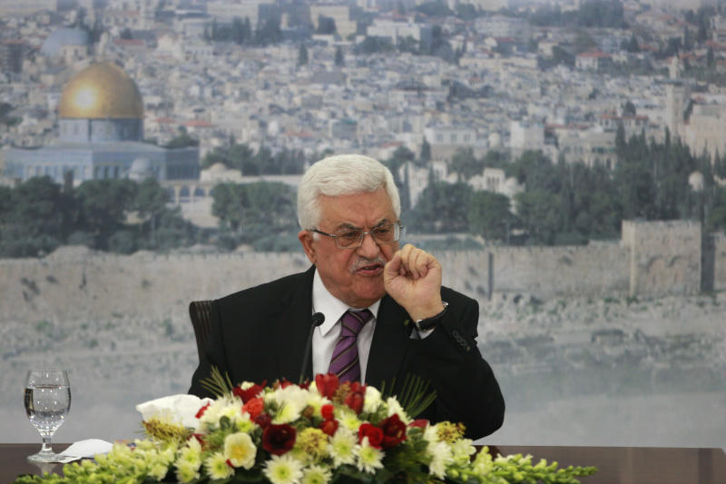 Palestinian President Mahmoud Abbas speaks during a meeting at his compound in the West Bank city of Ramallah, Saturday, Jan. 11, 2014. (AP Photo/Majdi Mohammed)