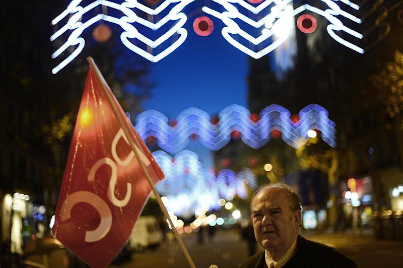 A man takes part during a protest against austerity measures, including Spanish state pensions in Barcelona, Spain, Monday, Dec. 17, 2012. The demonstrations have been called by the country's main labor unions and a wide array of social movement groups.(AP Photo/Manu Fernandez)