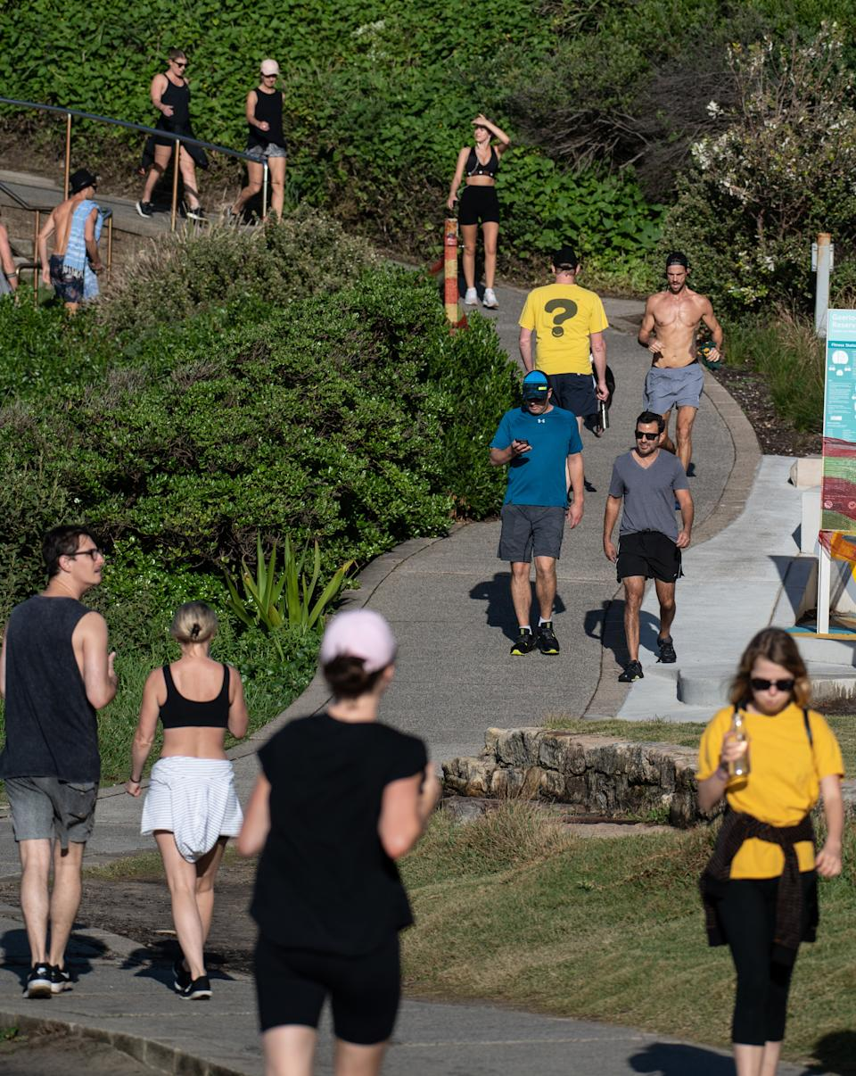People out on the coastal walk near Mackenzies Bay, in Sydney on March 28, 2020. Source: AAP Image/James Gourley