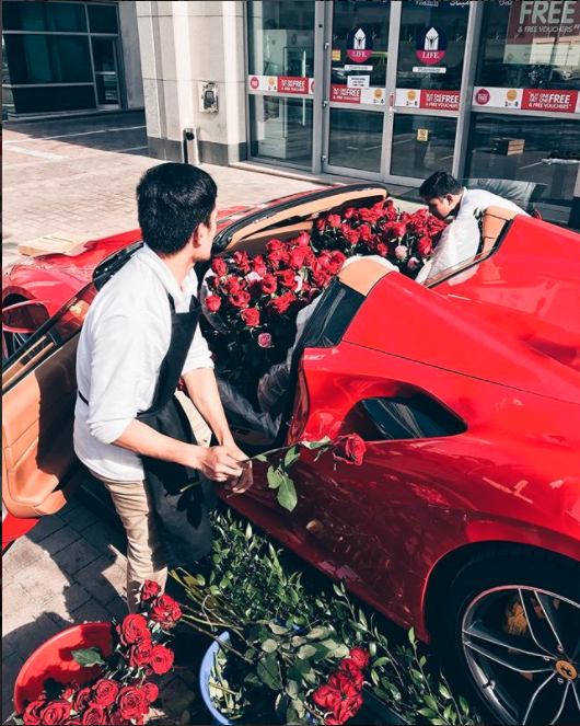 This Instagram star filled a Ferrari up to the brim with red roses. Photo: Instagram/supercarblondie