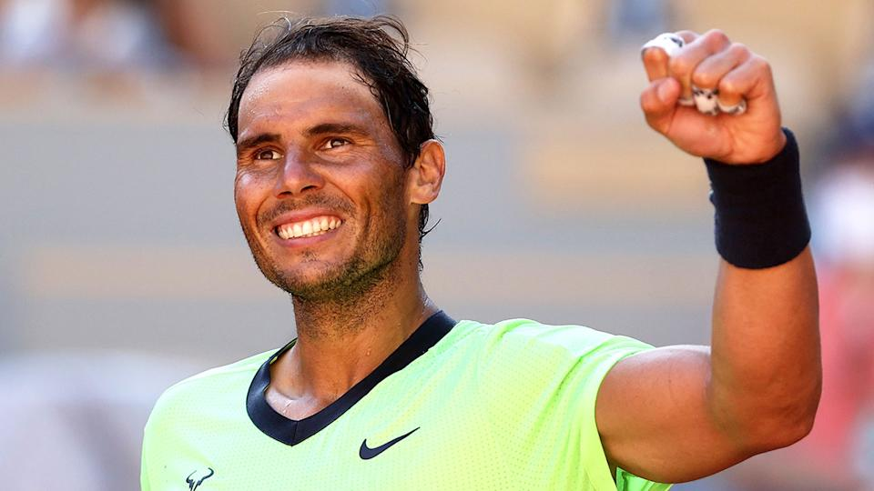 Rafael Nadal raises a fist after his French Open first round win.