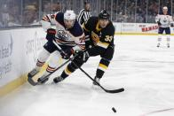 Edmonton Oilers' Leon Draisaitl (29) ad Boston Bruins' Zdeno Chara (33) battle for the puck during the second period on an NHL hockey game in Boston, Saturday, Jan. 4, 2020. (AP Photo/Michael Dwyer)