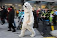 A person dressed as a polar bear walks in Geneva on November 28, 2015 during a rally ahead of the UN climate summit COP21 (AFP Photo/Fabrice Coffrini)