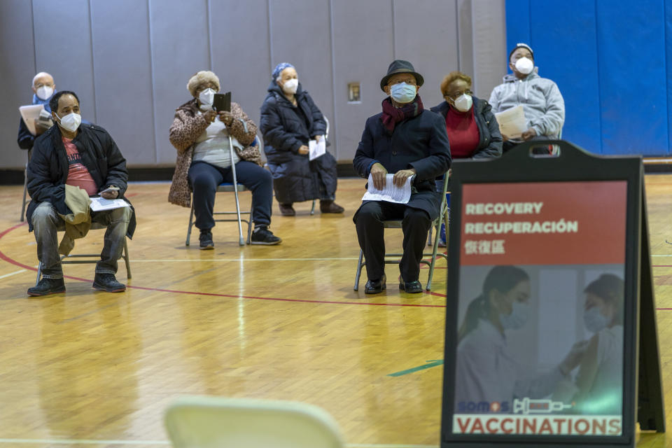 Seniors wait to be to register for the first dose of the coronavirus vaccine at a pop-up COVID-19 vaccination site at the Bronx River Community Center, Sunday, Jan. 31, 2021, in the Bronx borough of New York. (AP Photo/Mary Altaffer)