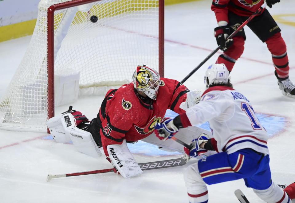Montreal Canadiens right wing Josh Anderson (17) blasts the puck past Ottawa Senators goaltender Matt Murray (30) during the third period of an NHL hockey game in Ottawa on Saturday, Feb. 6, 2021. (Sean Kilpatrick/The Canadian Press via AP)