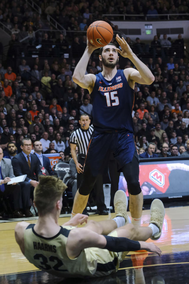 Illinois forward Giorgi Bezhanishvili (15) continues to the basket after committing an offensive foul on Purdue center Matt Haarms (32) during the first half of an NCAA college basketball game in West Lafayette, Ind., Wednesday, Feb. 27, 2019. (AP Photo/AJ Mast)