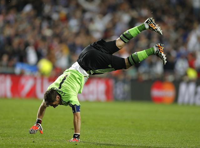 Real goalkeeper Iker Casillas celebrates after Real's Marcelo scores his side's 3rd goal, during the Champions League final soccer match between Atletico de Madrid and Real Madrid in Lisbon, Portugal, Saturday, May 24, 2014. (AP Photo/Daniel Ochoa de Olza)