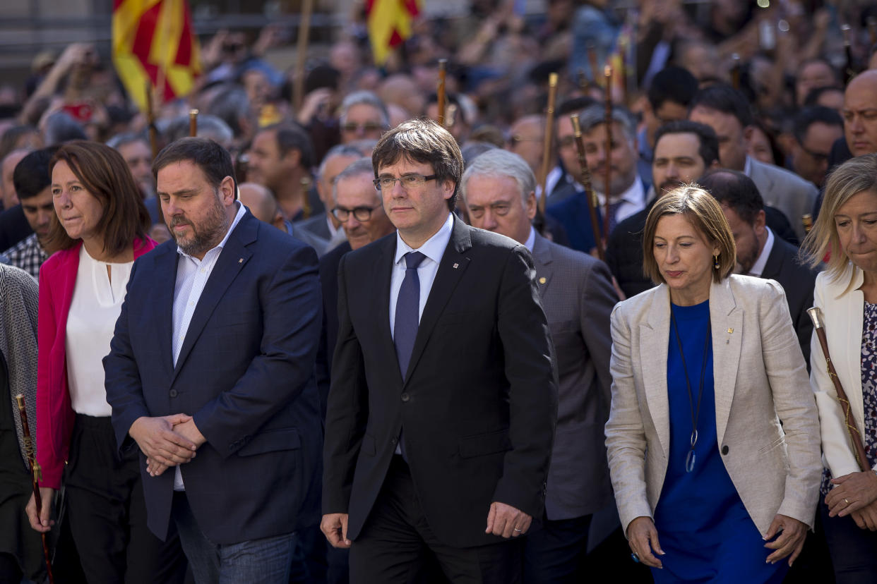 Catalan President Carles Puigdemont, center, during a demonstration in Barcelona, Sept. 16, 2017. (Photo: Miquel Llop/NurPhoto via Getty Images)