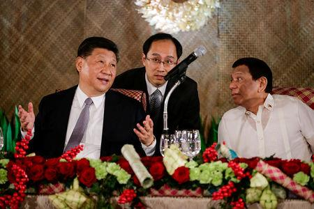 China's President Xi Jinping speaks as Philippine President Rodrigo Duterte listens during a State Banquet at the Malacanang presidential palace in Manila, Philippines, November 20, 2018.   Mark Cristino/Pool via Reuters