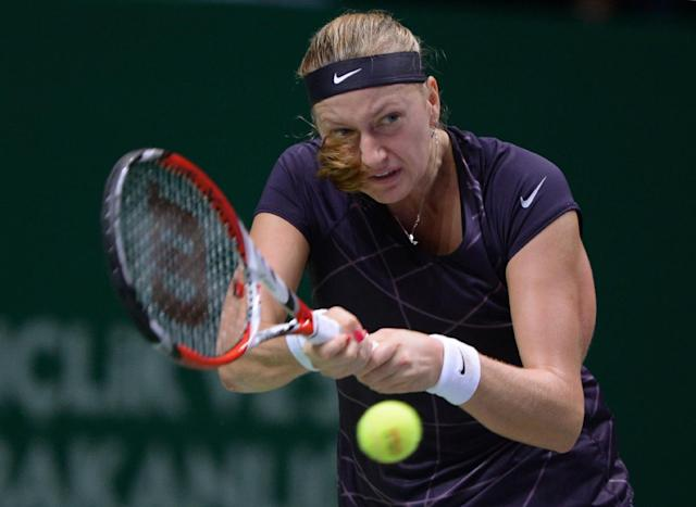 Petra Kvitova of the Czech Republic returns a shot to Li Na of China during their semifinal tennis match at the WTA Championship in Istanbul, Turkey, Saturday, Oct. 26, 2013. The world's top female tennis players compete in the championships which runs from Oct. 22 until Oct. 27.(AP Photo)