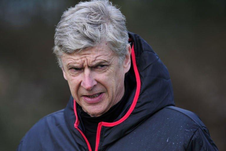 Arsenal manager Arsene Wenger takes training at London Colney, north of London, on February 18, 2013