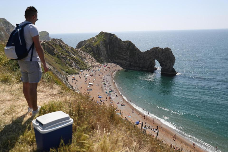 Sunseekers flocked to Durdle Door, near Lulworth in Dorset, this morning (PA)