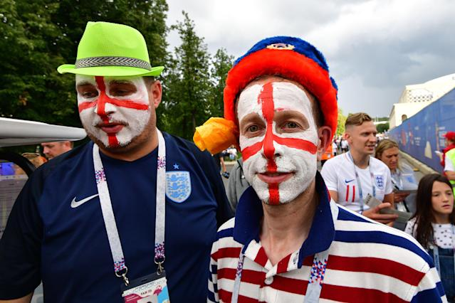 England fans prepare with painted visages.