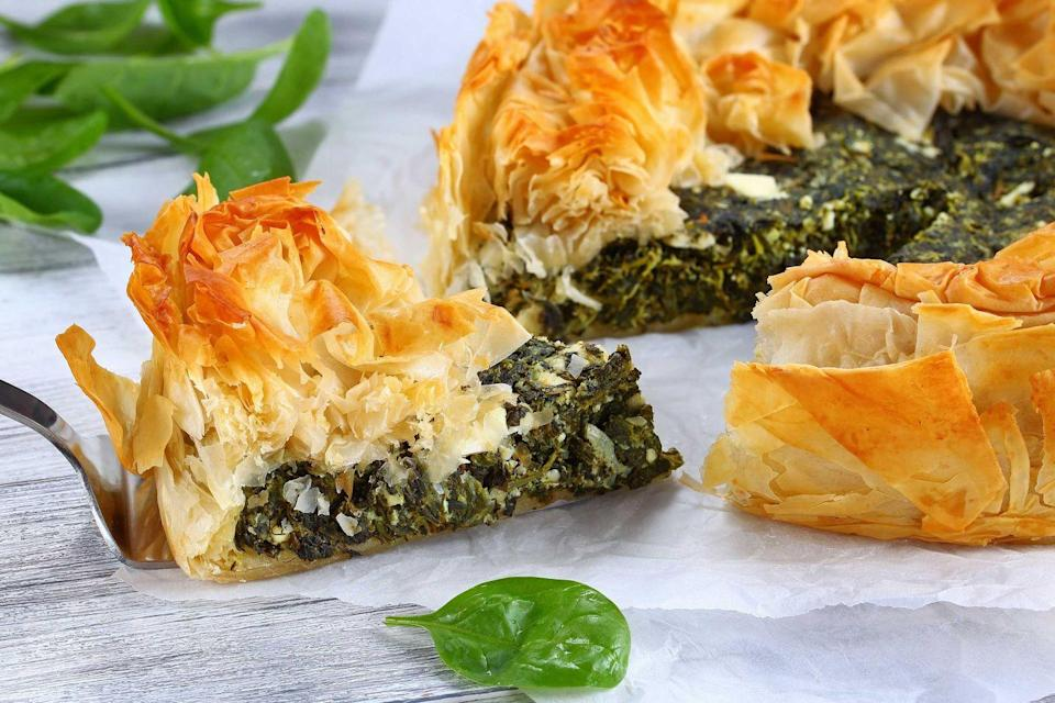 "<p>A bite of homemade spanakopita will instantly take you back to <a href=""https://www.countryliving.com/life/a32450726/summer-heat-predictions-2020/"" rel=""nofollow noopener"" target=""_blank"" data-ylk=""slk:summers"" class=""link rapid-noclick-resp"">summers</a> in Greece. Meaning ""spinach pie,"" It's a Greek savory pastry filled with spinach and feta, wrapped in filo dough. They're often shaped in triangles and Greeks have been eating these desserts since ancient times.</p><p><strong>Get the recipe at <a href=""https://www.delish.com/cooking/recipe-ideas/a26471474/spanakopita-spinach-pie-recipe/"" rel=""nofollow noopener"" target=""_blank"" data-ylk=""slk:Delish"" class=""link rapid-noclick-resp"">Delish</a>.</strong></p>"