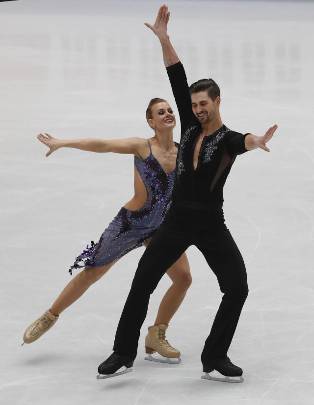U.S. Madison Hubbell and Zachary Donohue perform during the pairs Ice dance short program at the Figure Skating World Championships in Assago, near Milan, Friday, March 23, 2018. (AP Photo/Antonio Calanni)