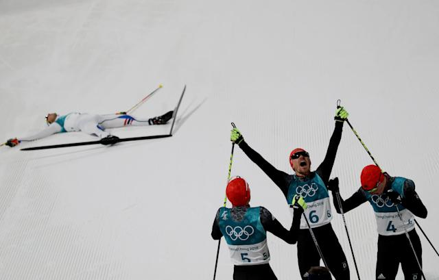 Nordic Combined Events - Pyeongchang 2018 Winter Olympics - Men's Individual 10 km Final - Alpensia Cross-Country Skiing Centre - Pyeongchang, South Korea - February 20, 2018 - Gold medalist, Johannes Rydzek of Germany, silver medalist, Fabian Riessle of Germany and bronze medalist Eric Frenzel of Germany celebrate as Jarl Magnus Riiber of Norway reacts. REUTERS/Carlos Barria