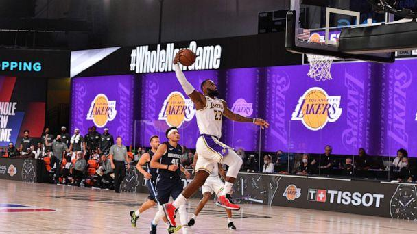 PHOTO: LeBron James of the Los Angeles Lakers dunks the ball against the Dallas Mavericks on July 23, 2020, at the Visa Athletic Center at ESPN Wide World of Sports Complex in Orlando, Fla. (Jesse D. Garrabrant/NBAE via Getty Images)