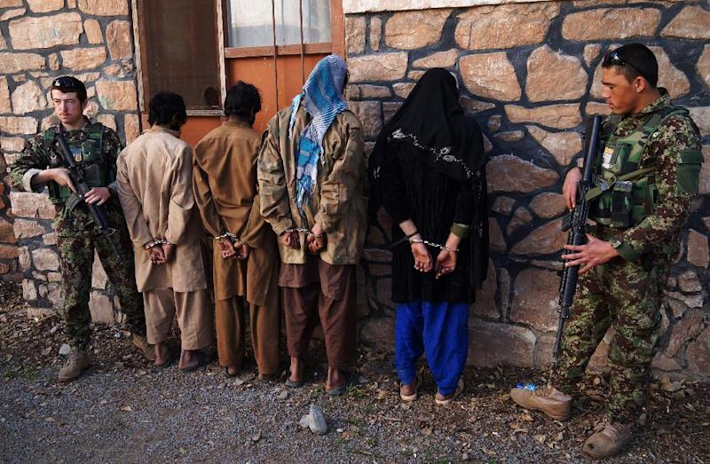 Afghan security personnel present four suspected Taliban fighters to the media at the Afghan National Army headquarters in Jalalabad, February 5, 2015 (AFP Photo/Noorullah Shirzada)