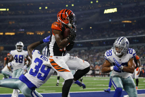 File-This Aug. 18, 2018 file photo shows Cincinnati Bengals wide receiver John Ross, center, making a catch to complete a two point conversion between Dallas Cowboys cornerback Marquez White (39) and safety Jameill Showers (28) during a preseason NFL Football game in Arlington, Texas. Ross returns this week from a shoulder injury, giving the Cincinnati Bengals the deep threat theyve lacked. He was injured during a Monday night game in Pittsburgh. (AP Photo/Roger Steinman, File)