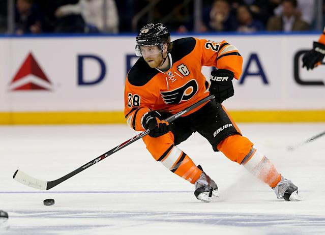 NEW YORK, NY - NOVEMBER 19: Claude Giroux #28 of the Philadelphia Flyers takes the puck in the third period against the New York Rangers on November 19, 2014 at Madison Square Garden in New York City.The New York Rangers defeated the Philadelphia Flyers 2-0. (Photo by Elsa/Getty Images)