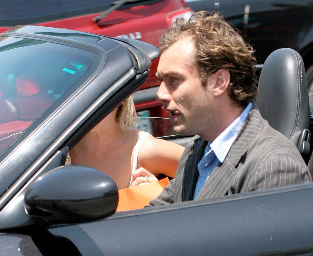 """Jude Law dashes around in a convertible Porsche. Close your mouth or bugs will fly in there! <a href=""""http://www.x17online.com"""" target=""""new"""">X17 Online</a> - May 28, 2006"""
