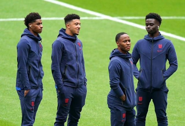 England duo Marcus Rashford, left, and Raheem Sterling, second right, have each been made MBEs