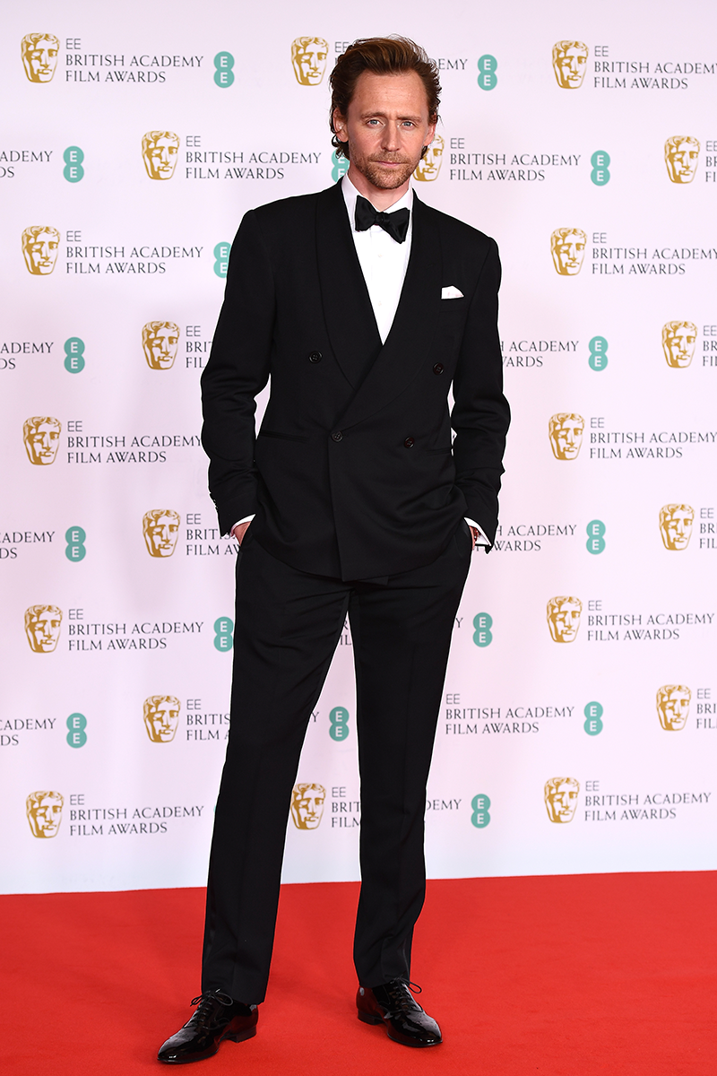<p>Tom Hiddleston is dapper AF in this black-tie outfit.</p>