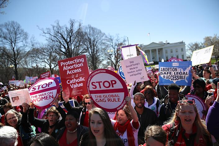 Protesters rallying in support of women's health programs and against the White House global gag rule, March 8, 2017. (Photo: Justin Sullivan/Getty Images)