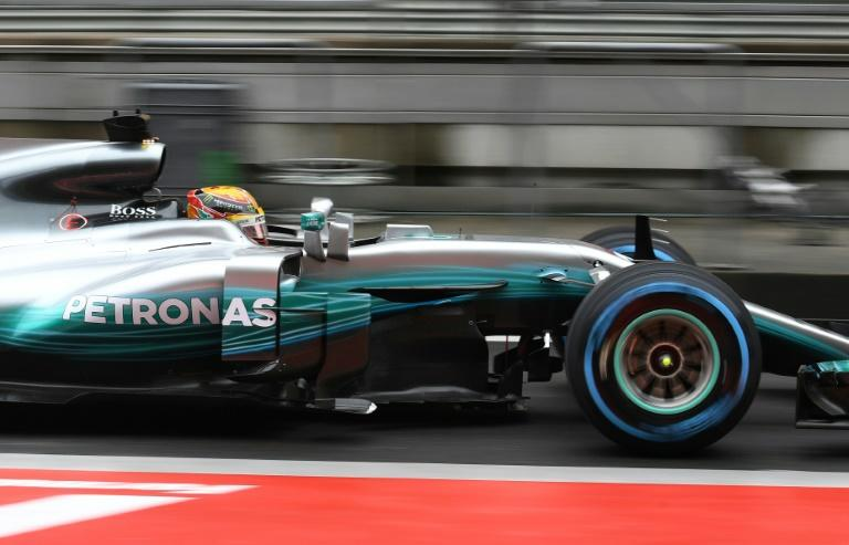 Lewis Hamilton drives through pit lane during a practice session ahead of the Formula One Chinese Grand Prix in Shanghai, where he is seeking his first win of the season