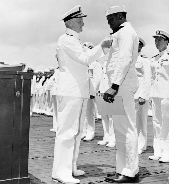 PHOTO: Adm. Chester Nimitz awards the Navy Cross medal to Mess Attendant 2nd Class Doris Miller for his actions aboard the battleship USS West Virginia (BB-48) during the Dec. 7, 1941 Japanese attack on Pearl Harbor. (U.S. Navy)