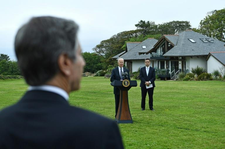 US Secretary of State Antony Blinken listens as US President Joe Biden makes a speech on the Covid pandemic, while Pfizer CEO Albert Bourla stands alongside him, in the Cornish town of St Ives ahead of the G7 summit