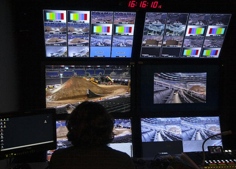In this Wednesday, June 27, 2012 photo, an unidentified 3-D TV operator checks camera settings for a 3-D production for ESPN 3-D Network at the Staples Center in Los Angeles. Only 2 percent of TVs in American homes were able to show 3-D last year, according to IHS Screen Digest. That's about 6.9 million sets out of 331 million installed. (AP Photo/Damian Dovarganes)