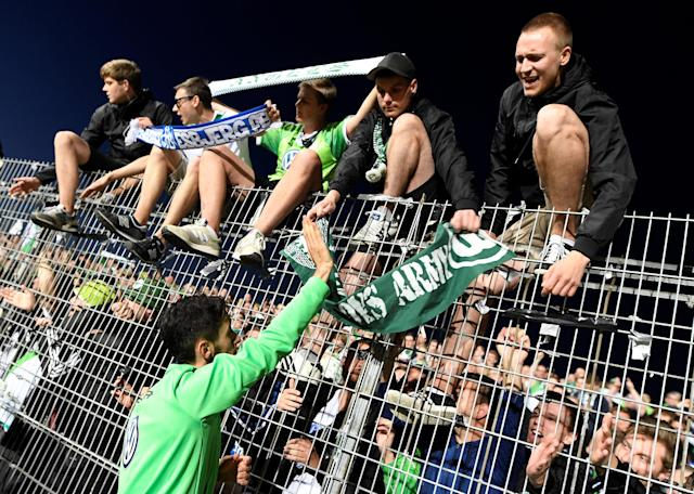 Soccer Football - Bundesliga Promotion/Relegation Playoff Second Leg - Holstein Kiel vs VfL Wolfsburg - Holstein-Stadion, Kiel, Germany - May 21, 2018 Wolfsburg's Yunus Malli celebrates with fans after the match REUTERS/Fabian Bimmer DFL RULES TO LIMIT THE ONLINE USAGE DURING MATCH TIME TO 15 PICTURES PER GAME. IMAGE SEQUENCES TO SIMULATE VIDEO IS NOT ALLOWED AT ANY TIME. FOR FURTHER QUERIES PLEASE CONTACT DFL DIRECTLY AT + 49 69 650050