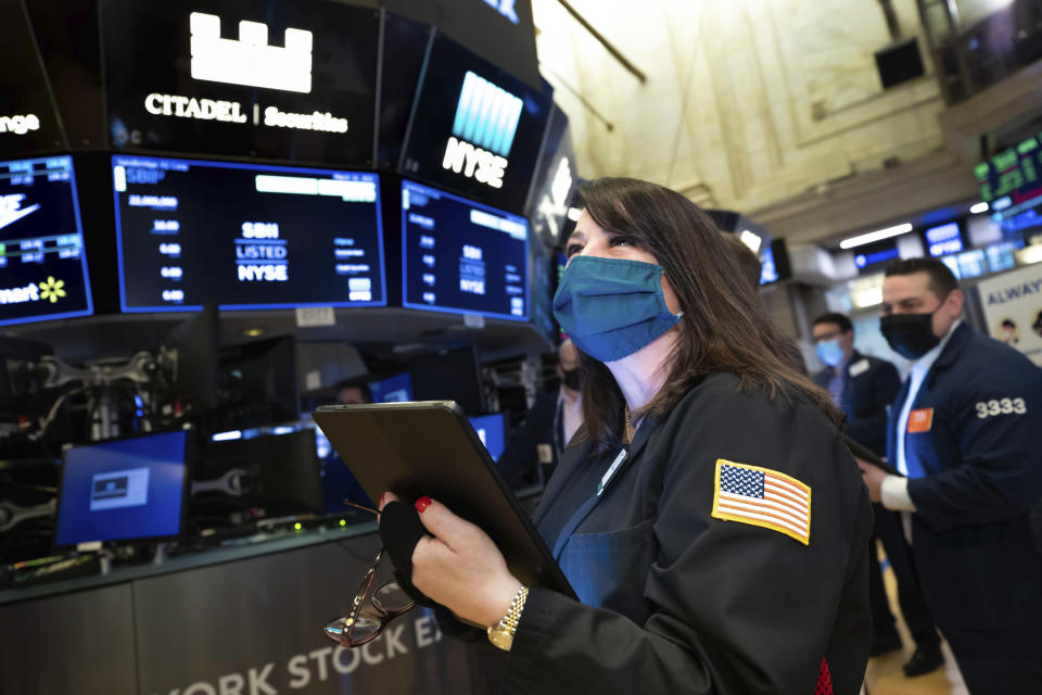 FILE - In this Wednesday March 10, 2021 photo provided by the New York Stock Exchange, trader Phyllis Arena Woods works on the trading floor. A year earlier, a terrifying free fall for the stock market suddenly ended, ushering in one of its greatest runs. (Nicole Pereira/New York Stock Exchange via AP)