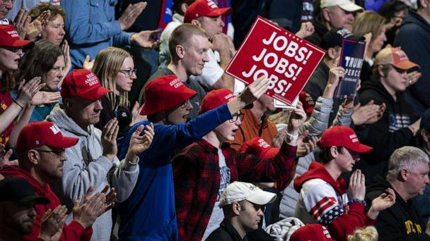 PHOTO: An attendee holds up a sign that reads 'Jobs! Jobs! Jobs!' during a campaign rally for President Donald Trump in Des Moines, Iowa, Jan. 30, 2020. (Bloomberg via Getty Images, FILE)