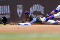 Miami Marlins' Jazz Chisholm Jr., left, steals second as Chicago Cubs second baseman Eric Sogard applies a late tag during the first inning of a baseball game in Chicago, Saturday, June 19, 2021. (AP Photo/Nam Y. Huh)