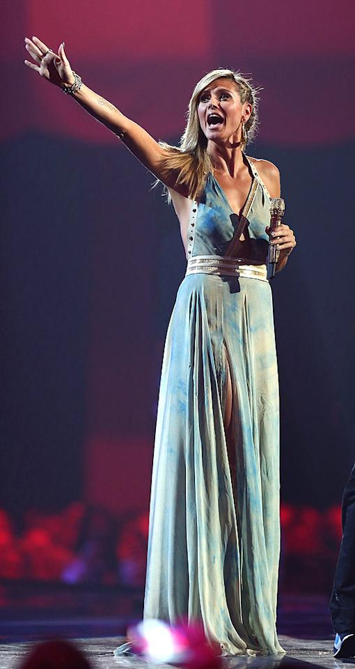FRANKFURT AM MAIN, GERMANY - NOVEMBER 11:  Presenter Heidi Klum onstage during the MTV EMA's 2012 at Festhalle Frankfurt on November 11, 2012 in Frankfurt am Main, Germany.  (Photo by Andreas Rentz/Getty Images for MTV)