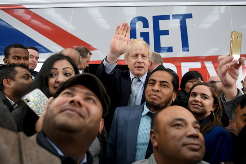 Prime Minister Boris Johnson is surrounded by supporters at the unveiling of the Conservative Party battlebus in Middleton, Greater Manchester. (Photo: PA Wire/PA Images)