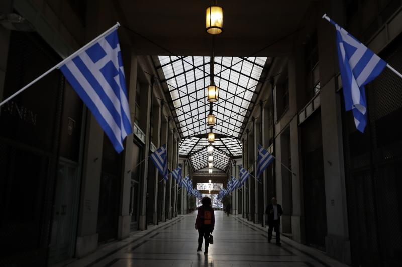 Greece says new bailout terms agreed with lenders