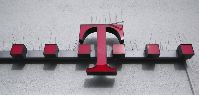 Spikes against doves are placed on the logo of German telecommunications giant Deutsche Telekom AG at a Telekom mobile phones store in the city centre of the western German city of Koblenz